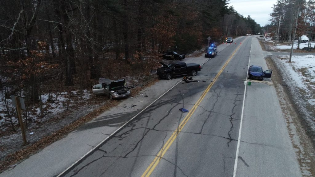 Police say Dale H. Tucker of Casco rammed his Chevy Cobalt, right, into two vehicles after losing control while trying to avoid a spike mat that was put down by deputies as he was fleeing police on Route 302 in Raymond on Sunday.