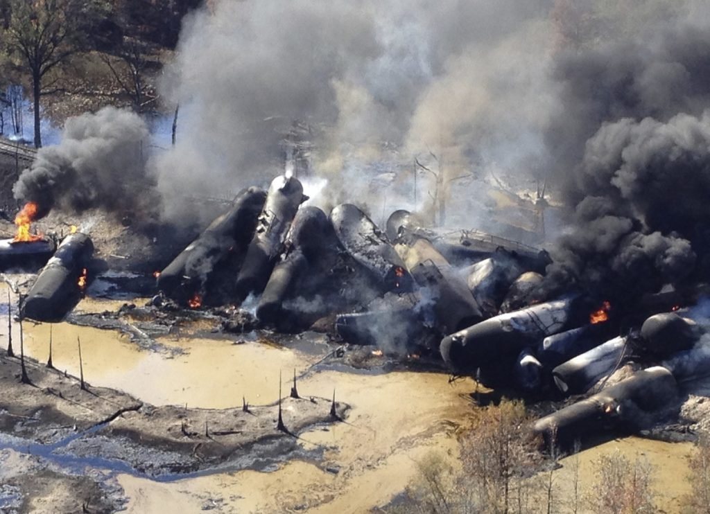 A tanker train carrying crude oil burns after derailing in western Alabama in 2013. The Trump administration vastly understated the potential benefits of installing more advanced brakes on trains that haul explosive fuels.