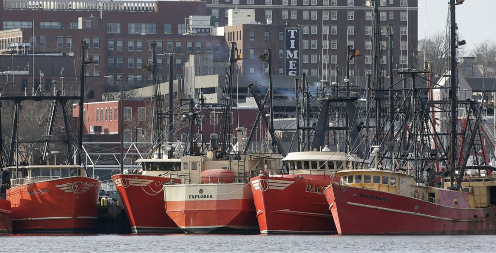 Fishing trawlers float at the dock in New Bedford Harbor in Massachusetts. The state's seafood industry is pushing for changes in lobster processing rules that would allow it to expand, and the port seems well-positioned for increased production. It has an excellent immigrant labor force and all the infrastructure of a major fish-processing center, including cold storage.