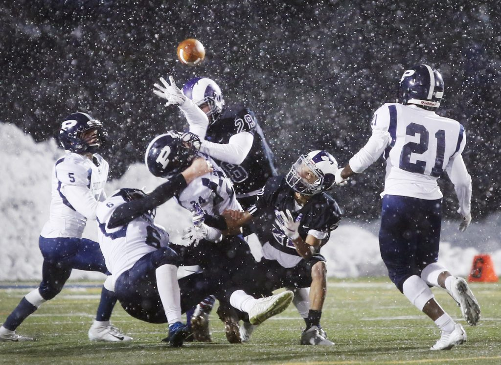 The prospect of a combined football team, featuring players from both Deering and Portland High, would end a 100-plus-year tradition, the annual Thanksgiving Day game, like this one played in snowy conditions last fall.