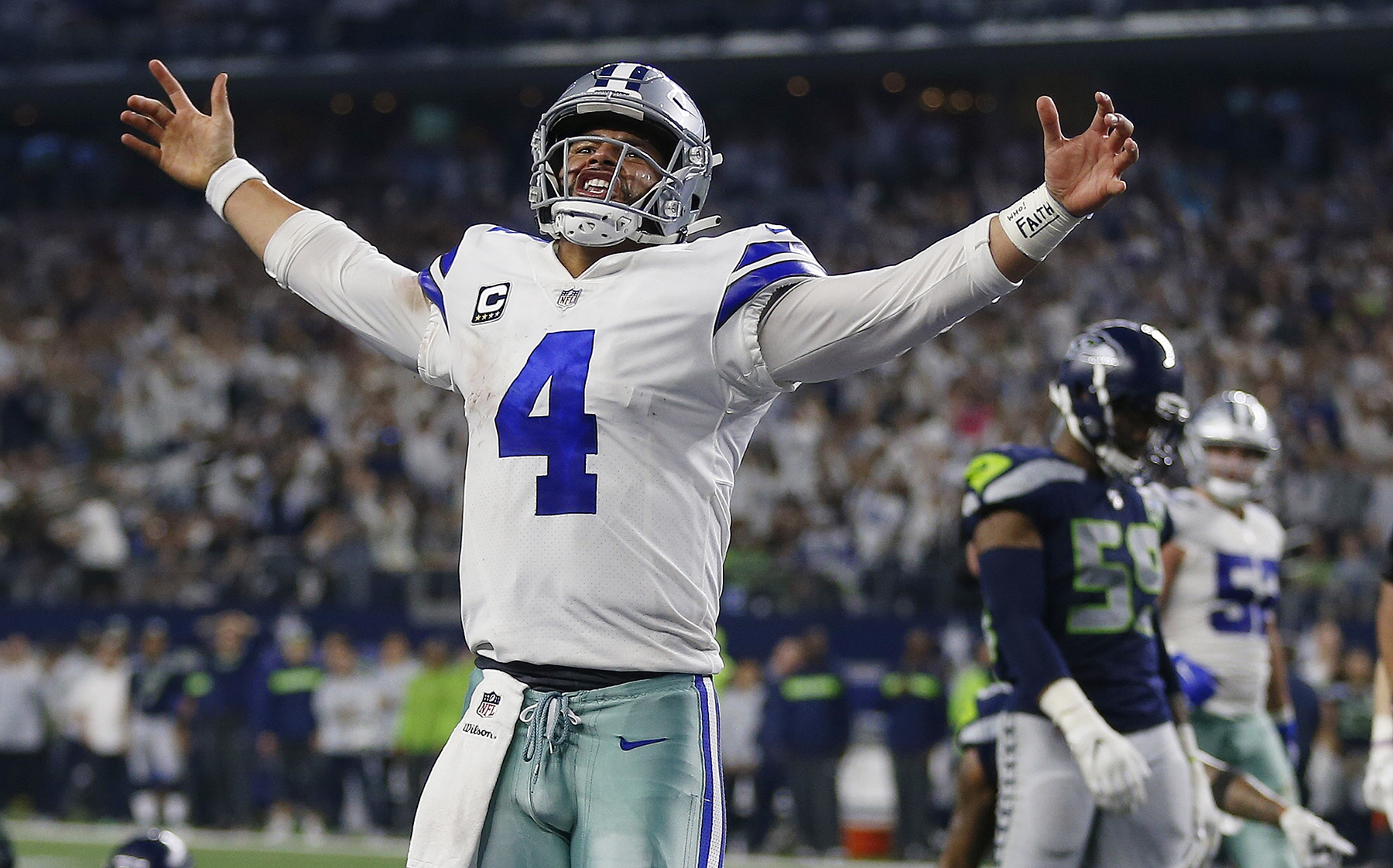 0c088db1a Dallas Cowboys quarterback Dak Prescott (4) celebrates his first down near  the goal line against the Seattle Seahawks during the second half of the  NFC wild ...
