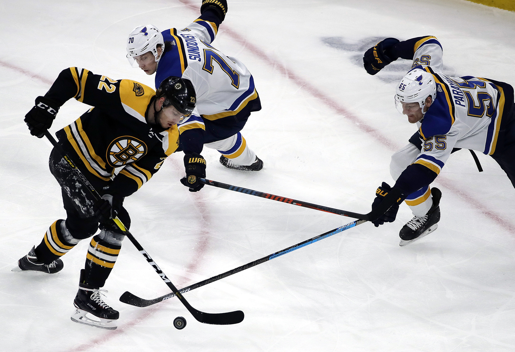 Boston Bruins left wing Peter Cehlarik (22) competes for the puck with St.  Louis Blues center Oskar Sundqvist (70) and defenseman Colton Parayko (55)  during ... 8b578989f