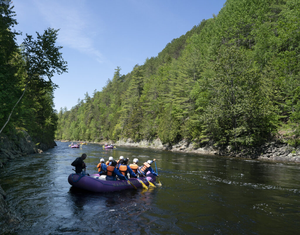 A raft heads down the Kennebec River near West Forks Plantation on June 13. The controversial CMP transmission line would run through western Maine.