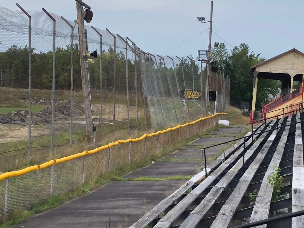 The Unity Raceway grandstands overlook a racetrack that was removed of asphalt at the end of the 2017 season. Repairs are needed to the covered grandstand, some of the fencing and other parts of the property.