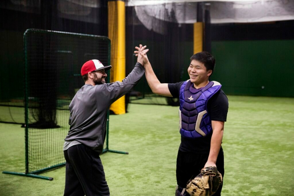 Princehoward Barbecue Yee high-fives his coach, Marcus Crowell, during his training at Hitters Count in Saco last week. Yee, 16, trains for three hours a day five days week.