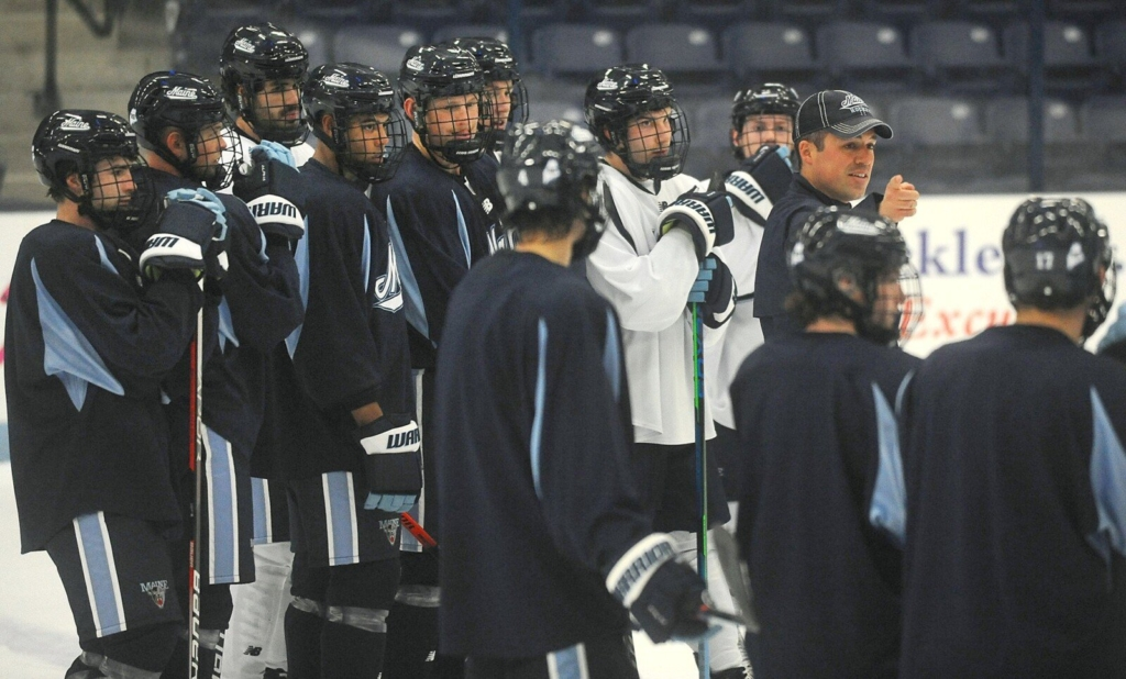 University of Maine men's hockey coach Ben Barr, right, directs the team during practice at Alfond Arena in Orono last week.