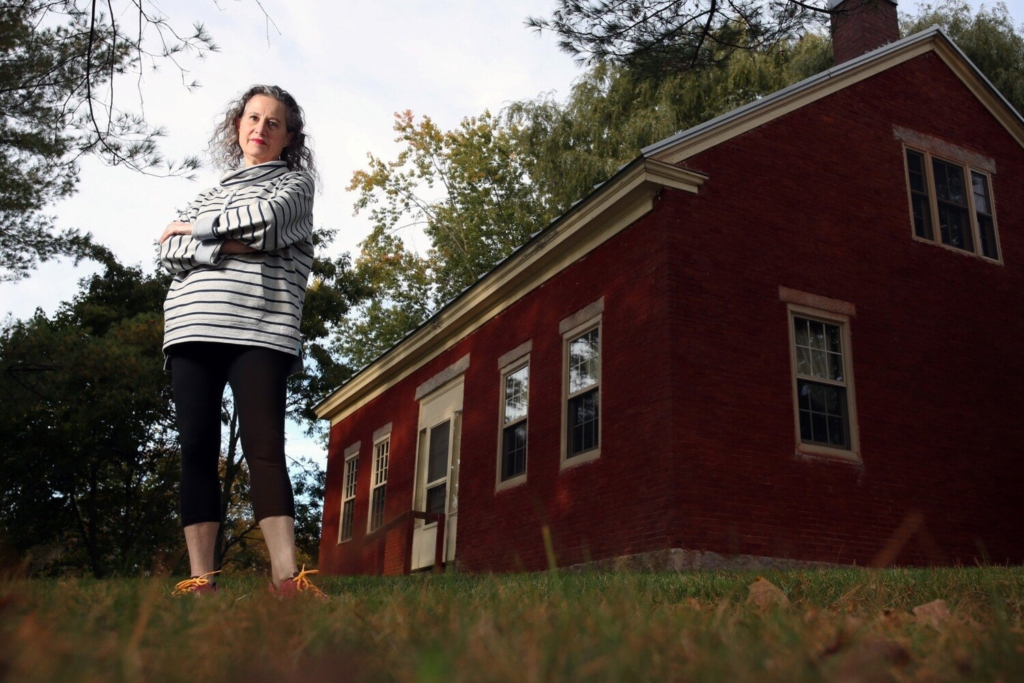 Veronique Plesch's home in Fairfield is next to fields where sludge was spread over the years. The state budget passed earlier this summer contains $30 million to test more than 500 sites statewide that received municipal sludge for use as fertilizer.