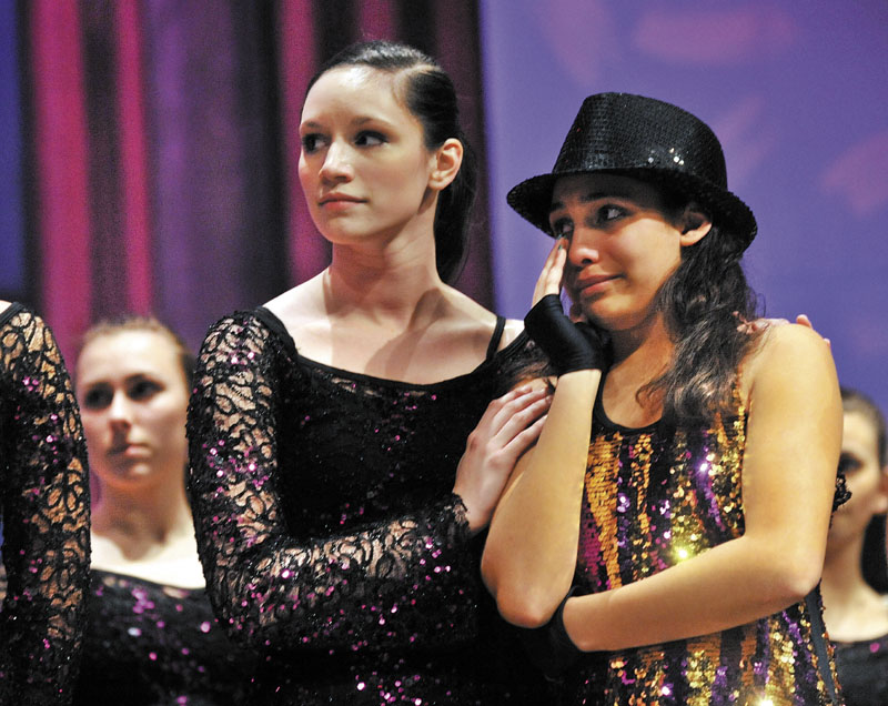 IN MEMORY: Ballet Technique Assistant Instructor Megan McQuarrie, 18, comforts Breona Henderson, 13, right, the recipient of the 2011 Brittney LaBrie Scholarship at the Messalosnkee Performing Arts Center in Oakland on Thursday evening.