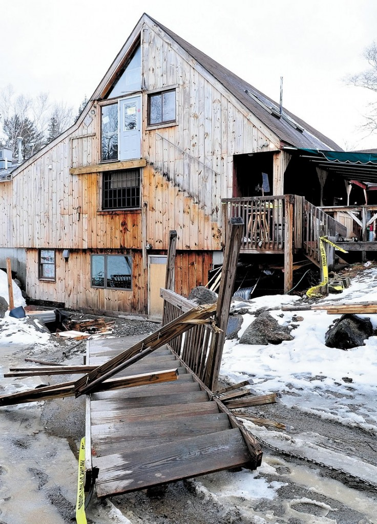 COLLAPSE: A set of stairs leading to a second-floor doorway at The Rack bar and grill restaurant in Carrabassett Valley is shown on the ground Sunday.