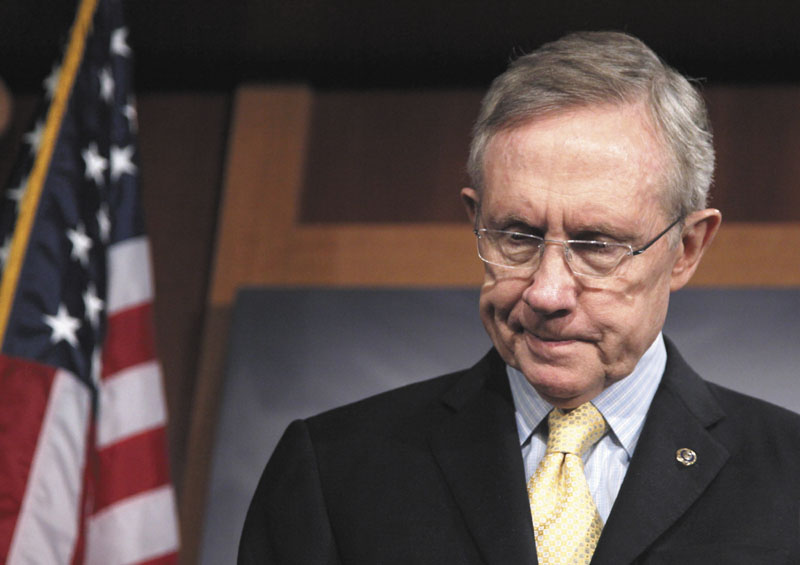ON CAPITOL HILL: Senate Majority Leader Harry Reid steps away from the podium after a news conference in Washington on Thursday.