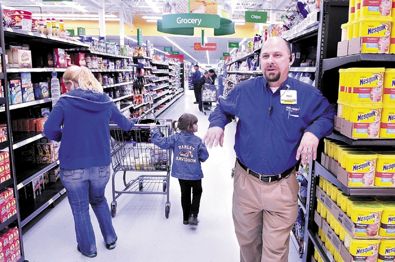 BIGGER: Walmart Supercenter store manager Paul Conklin speaks about the expansion of the Skowhegan store on Monday. The store will have its official opening Wednesday.