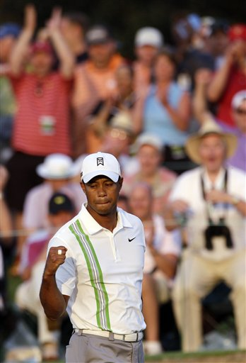 Tiger Woods pumps his fist after a birdie on the 18th hole during the second round of the Masters on Friday in Augusta, Ga.