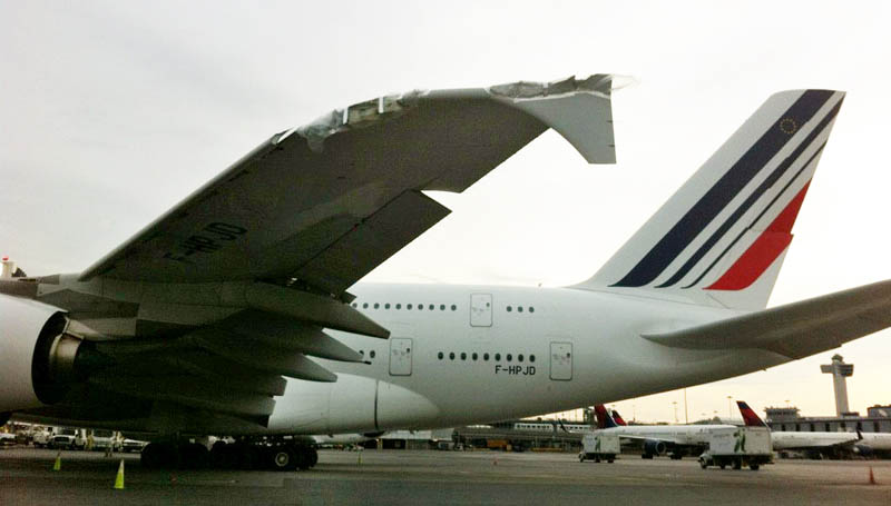 The damaged Airbus A380 belonging to Air France sits on the runway at John F. Kennedy International Airport today.