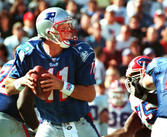 A 1997 photo of New England Patriots quarterback Drew Bledsoe dropping back to pass.