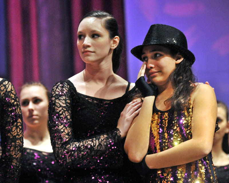 Assistant instructor Megan McQuarrie, 18, comforts Breona Henderson, 13, right, the recipient of the 2011 Brittany LaBrie Scholarship, at the Messalonskee Performing Arts Center in Oakland on Thursday evening.