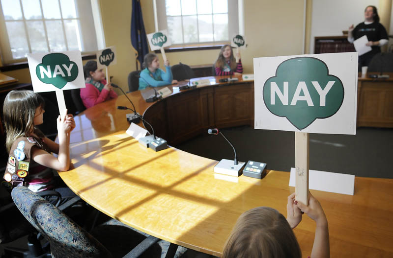 Girl Scouts from around the state vote against a proposal to drop a line of cookies during a debate Thursday at the Statehouse. The fourth annual Girl Scout Cookie Debate introduced Scouts to the legislative process. Rep. Joyce Fitzpatrick, R-Houlton, attended the event.