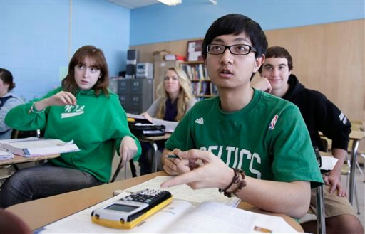 In this Tuesday, March 8, 2011 photo, Chinese student Minzhe Zou answers a question in statistics class Orono High School in Orono, Maine. Minzhe Zou has credited his year at the public school with helping him get accepted to five U.S. colleges.
