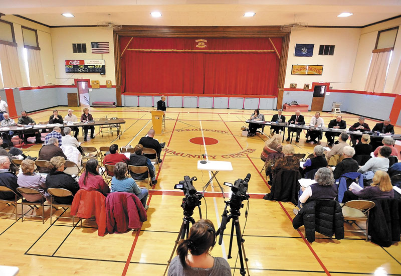 Farmington residents gather Saturday in the gymnasium during the town meeting at the Farmington Community Center.
