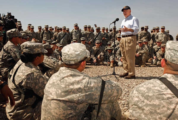 U.S. Defense Secretary Robert Gates talks with troops from the U.S. Army 25th Infantry Division today and answers their questions during a visit at Camp Victory in Baghdad, Iraq.