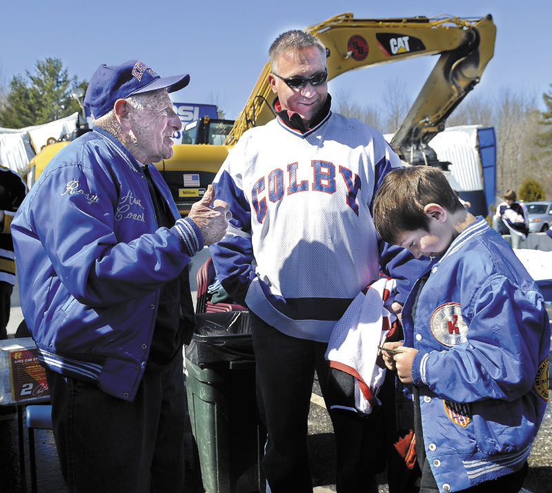 Cody Turner, right, is introduced to Rosy Santerre, left, by Turner's father, Eric, Sunday during a rally to show support for hockey at the Kennebec Ice Arena in Hallowell. In the 1970s, Santerre, a legend in the Maine hockey community, coached the elder Turner, who went on to play at Colby College. Santerre and Peter Prescott own the arena, which collapsed in March. Several hundred people attended the rally.