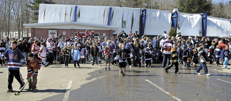 People congregate Sunday outside the Kennebec Ice Arena in Hallowell to show support for youth hockey. Several hundred people attended the event at the rink that collapsed in March.
