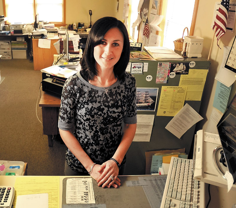 Melissa Patterson, a Benton selectwoman and town office clerk, pictured above, would see her service cut short if the legislature approves a proposal by Rep. David Cotta, R-China, that would make it illegal for an elected municipal officer to simultaneously be a town employee.