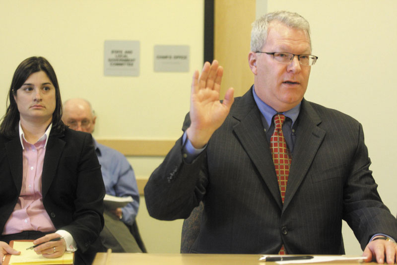 Former Maine Turnpike Authority executive director Paul Violette takes an oath while appearing before the Legislature's Government Oversight Committee at the State House in Augusta on Friday. Violette, with advice from his attorney, repeatedly declined to answer questions from the committee regarding gift card purchases.