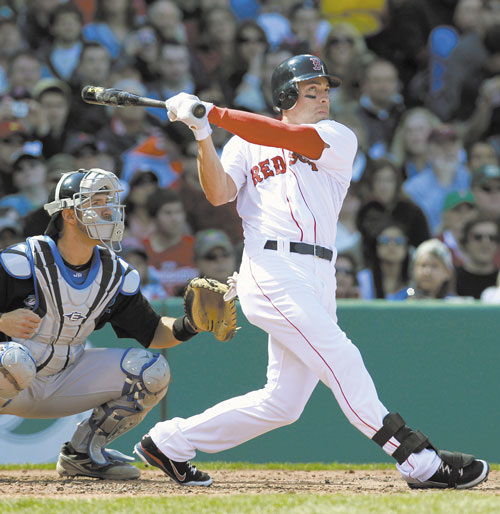BREAKING OUT: Boston's Jacoby Ellsbury, right, watches his three-run home run in front of Toronto catcher J.P. Arencibia in the second inning Sunday in Boston.