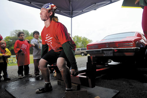 Staff photo by Andy Molloy A TOUGH MAN: James Fuller of Hallowel, attempts to dead lift car at a strongman competition in Augusta. Fuller will be one of aobut 30 contestants to compete in the Central Maine Strongman Competition Saturday at the Augusta Armory.