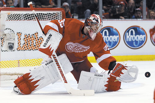 AP photo ADDING PRESSURE: The Detroit Red Wings are counting on Jimmy Howard, the former University of Maine star, as their goalie of the future. The Red Wings draw the Phoenix Coyotes.