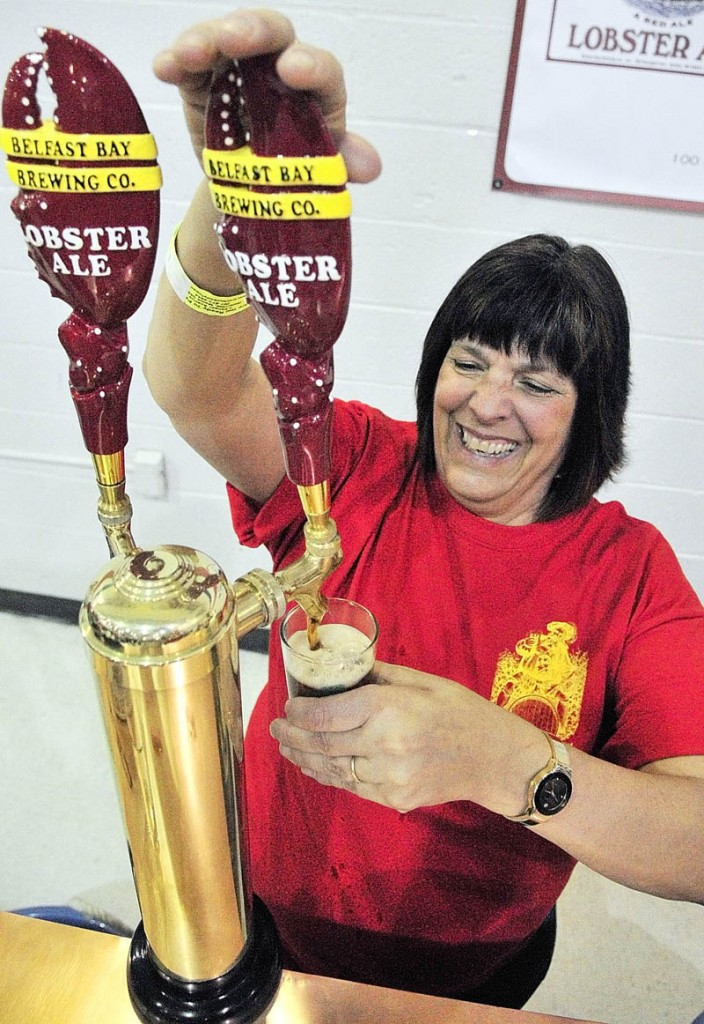 Marietta Crocker pulls a sample of Belfast Bay Brewing Company Lobster Ale at the Third Annual Central Maine Brew Fest on Saturday afternoon in the Augusta State Armory.