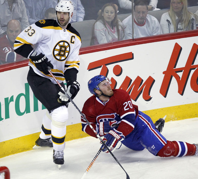 Boston Bruins defenseman Zdeno Chara, left, checks Montreal Canadiens defenseman James Wisniewski during the first period in Game 3 of their Eastern Conference first-round series Monday night in Montreal. Chara, who missed Game 2 on Saturday with what the team said was a case of dehydration, helped the Bruins win 4-2. The Canadiens lead the best-of-seven series 2-1.