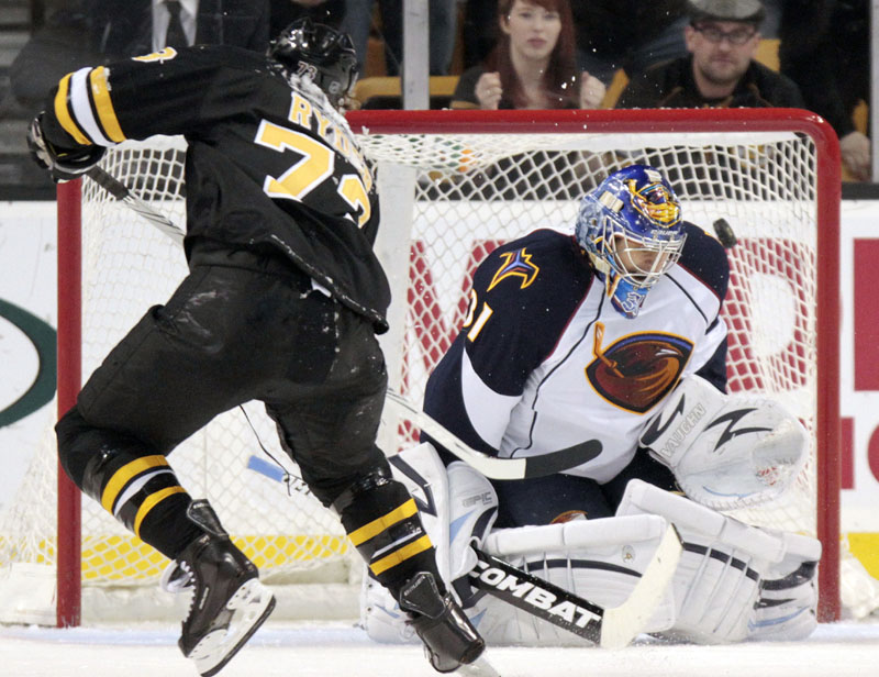 ONE-ON-ONE: Boston Bruins winger Michael Ryder, left, scores the go-ahead goal on a penalty shot against Atlanta Thrashers goalie Ondrej Pavelec during the third period Saturda in Boston. The Bruins won 3-2 and clinched the Northeast Division title.