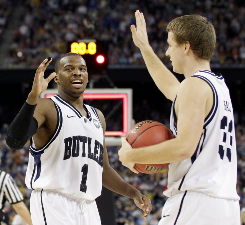 BACK AGAIN: Butler players Shelvin Mack, left, and Chase Stigall react after beating Virginia Commonwealth 70-62 in the Final Four on Saturday night in Houston. With that, Butler's in the championship game for a second straight season. Mack scored 24 points.