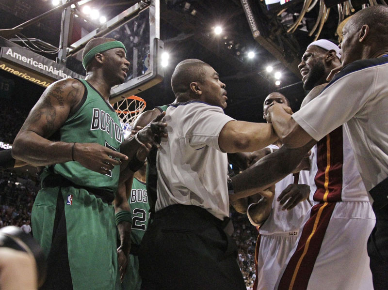 TENSE MOMENT: Heat guard LeBron James, right, exchanges words with Boston Celtics forward Jermaine O'Neal, left, after O'Neal fouled James during the second quarter Sunday in Miami. The Celtics lost 100-77. heat11 heatcletics MHS ADD heat