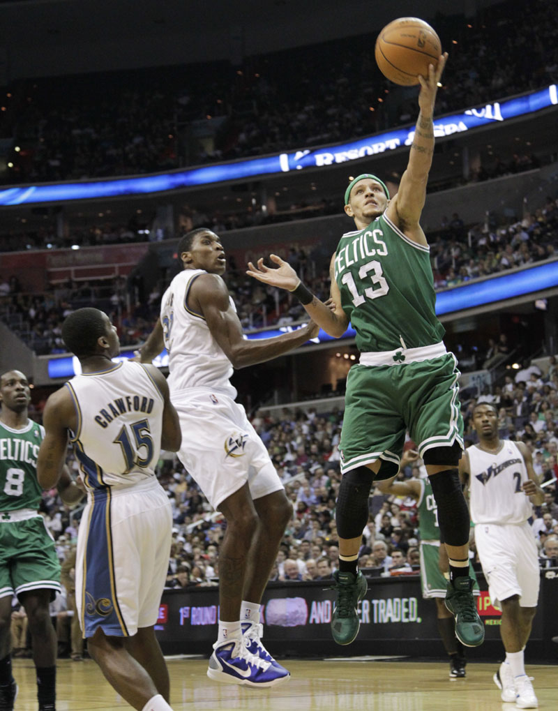 GOING IN: Boston Celtics guard Delonte West, right, shoots past Washington Wizards defenders during the first half of a 95-94 overtime loss Monday night in Washington. The Celtics sat four starters as the playoffs draw close.