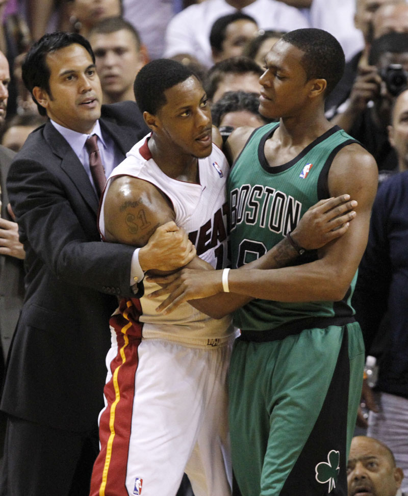 KEEPING THE PEACE: Miami Heat coach Erik Spoelstra, left, and Boston Celtics point guard Rajon Rondo, right, hold back Miami point guard Mario Chalmers during an altercation between the teams after Jermaine O'Neal fouled LeBron James in the second quarter Sunday evening in Miami. The Celtics lost 100-77.