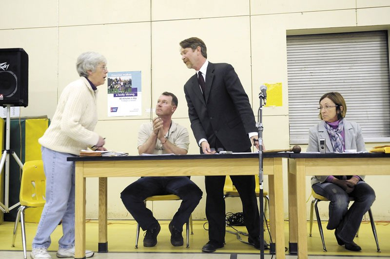 Town attorney Stephen Langsdorf consults Thursday with incoming Selectman Linda Leotsakos, left, at the first full meeting of the Board of Selectmen since the Feb. 10 arrest of Selectman Carole Swan, right. Selectman Michael Pushard is second from left.