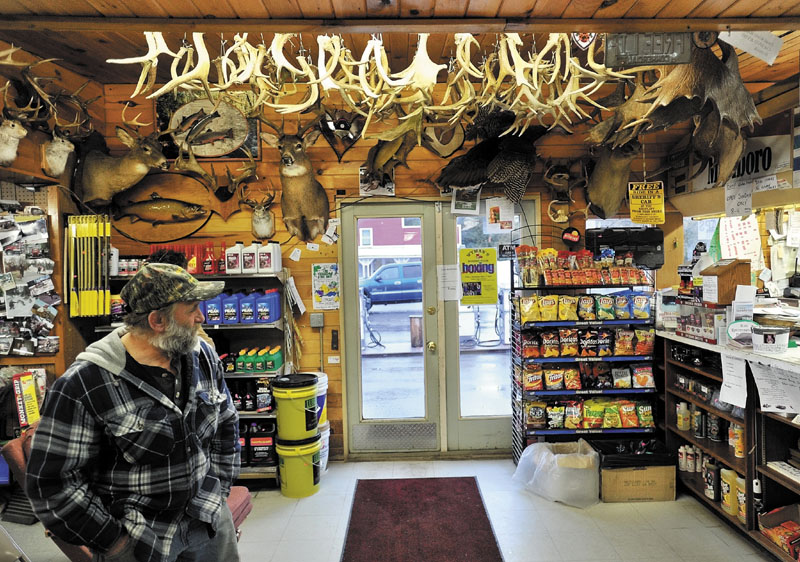 Ronnie Berry waits waits for his brother Gordon inside Berry's General Store on Tuesday evening. Gordon Berry was feeding a local herd of deer that congregate at the ball fields in West Forks.