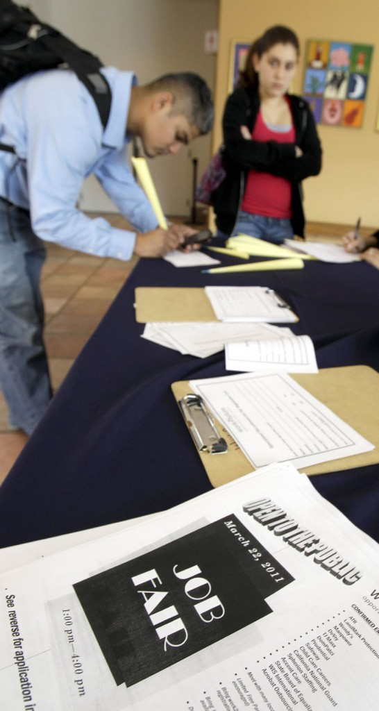 Job applicants fill out employment forms recently at a job fair in San Jose, Calif. The unemployment rate fell to a two-year low of 8.8 percent in March. Companies added workers at the fastest two-month pace since before the recession.