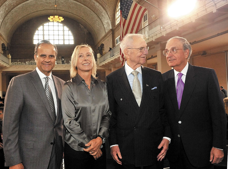 Waterville native and former U.S. Sen. George Mitchell, far right, joins fellow honorees of the annual Ellis Island Family Heritage Awards on Wednesday in the Great Hall of Ellis Island in New York. The others honored for their contributions to the American experience, left to right, are Joe Torre, Martina Navratilova and Lee Iacocca.