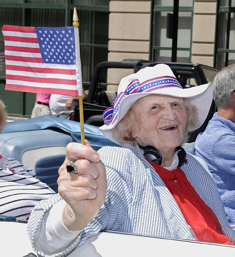 This July 2008 file photo shows Elsie Viles riding down Water Street when she was the 2008 Independence Day parade grand marshal in Augusta. augusta
