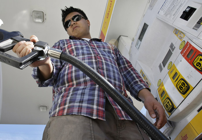 Daniel Dona pumps gas at a Shell gas station in Menlo Park, Calif., recently. With the price of gas above $3.50 a gallon in all but one state, there are signs that Americans are cutting back on driving, reversing a steady increase in demand for fuel as the economy improves.