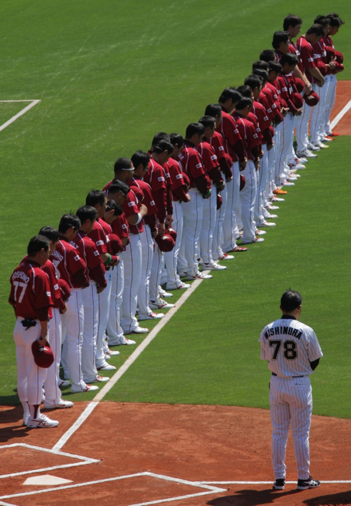 PAYING RESPECTS: Players of the Rakuten Golden Eagles, a Japanese professional baseball team based in Sendai, northeastern Japan, observe a moment of silence for victims of the March 11 earthquake and tsunami before their game against the Lotte Marrines on Tuesday in Chiba, near Tokyo. The 2011 pro baseball regular season kicked off Tuesday in Japan. 9.0 Magnitude Earthquake,Destru