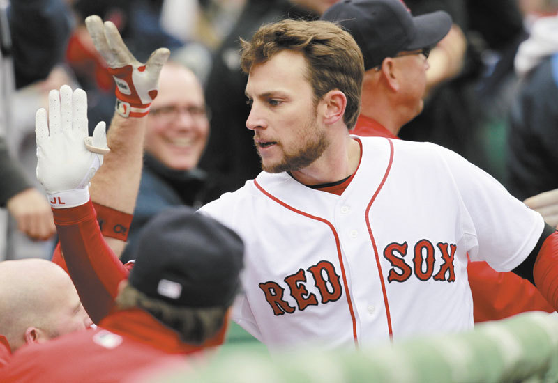 GIMME FIVE: Boston Red Sox shortstop Jed Lowrie celebrates after hitting a two-run home run in the second inning of the Red Sox' 4-1 win over the Toronto Blue Jays on Saturday at Fenway Park in Boston.