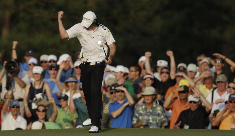 PRESSURE PUTT: Rory McIlroy celebrates after making a 25-foot birdie putt on the 17th hole during the third round of the Masters on Saturday in Augusta, Ga. He leads by four strokes.