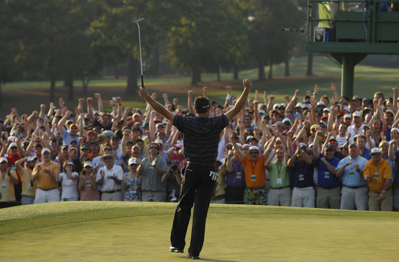 CLOSING THE DEAL: Charl Schwartzel celebrates after making a 20-foot birdie putt on the 18th hole during the final round of the Masters on Sunday in Augusta, Ga. The 26-year-old South African shot a 6-under 66 in the final round to win the green jacket by two strokes.