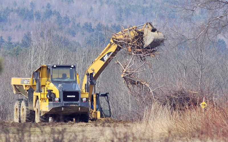 Heavy equipment moves to cut down apple trees on Tuesday afternoon in Readfield at the Kents Hill Orchard. Officials said the trees were already dead or dying, and the site will become a vegetable farm.