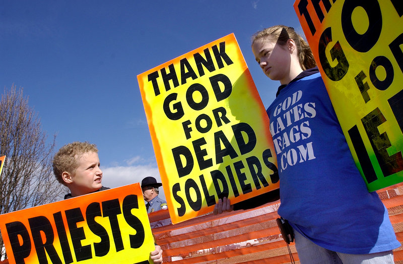 Westboro Baptist church members protest at a marine's funeral in this March 10, 2006, file photo. While current law places a 150-foot boundary around a military funeral service itself and 300 feet around access routes to the service, Snowe would up those lines to 300 feet and 500 feet. Snowe's bill also would impose criminal penalties on violators, including up to two years in prison.