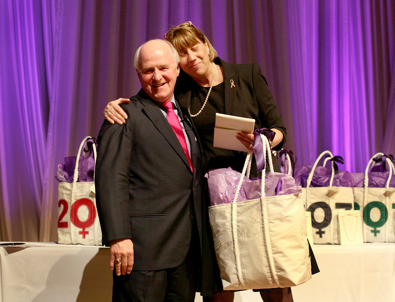 Honoree Meredith Strang Burgess of Burgess Advertising and Marketing hugs Richard Connor, editor and publisher of MaineToday Media, during the Great Women of Maine awards.